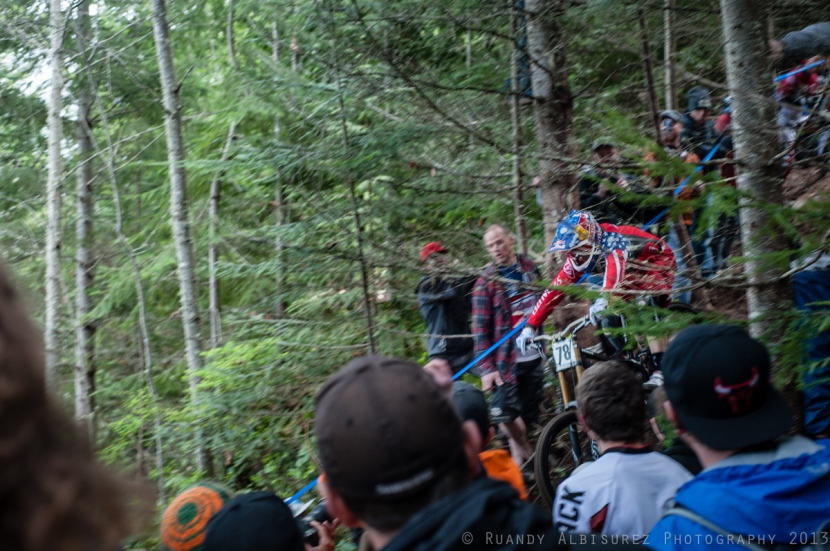 Aaron Gwin through the crowd gathered around Fairclough Falls