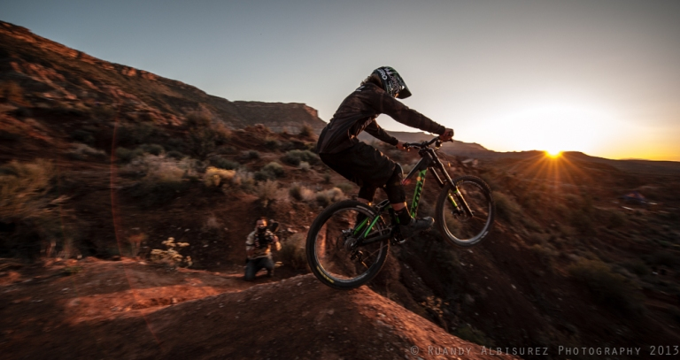 Graham Agassiz riding off of a drop into the sunset.