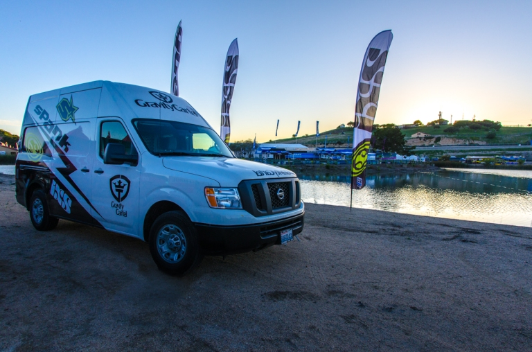 The Gravity Cartel van on the sand behind our tents.
