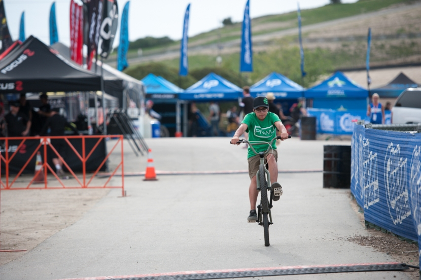 Gordo riding around on a BMX bike at the Sea Otter Grounds.