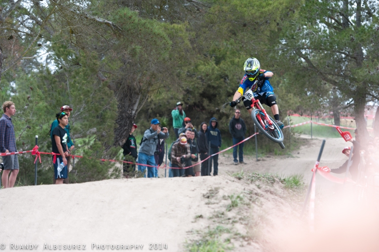 KHS/iXS/Spank team rider stylin over the tables on the course.