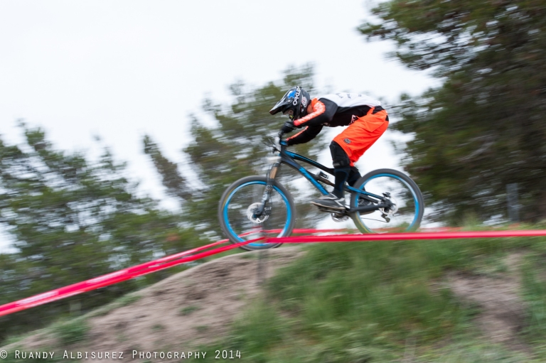 Madkats rider speed jumping the last table in the upper section