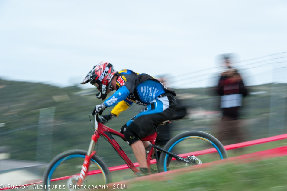 iXS/Spank Rider Logan Bingelli rocketing the straight away on the DH course
