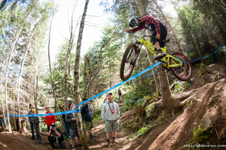 Mylan rocking the trail bike on the DH pro course